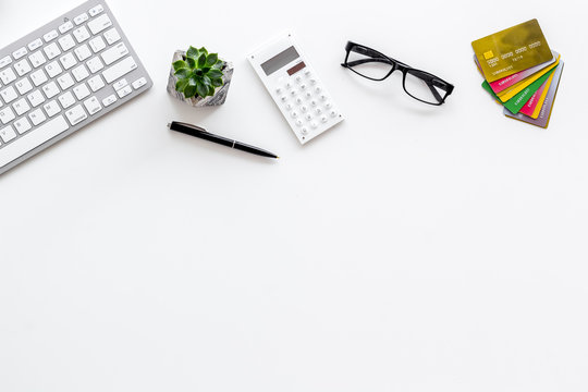 Banker work place with credit cards, keyboard and calculator on white background top view mockup