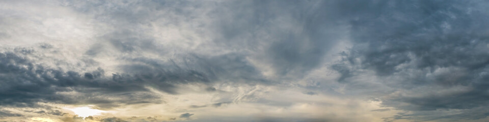 Dramatic panorama sky with storm cloud on a cloudy day. Panoramic image. Fotobehang