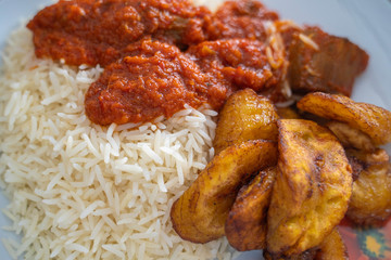 Nigerian Rice and Plantain - Dodo - with spicy Tomato Pepper Stew