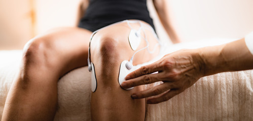 Knee Physical Therapy with TENS Electrode Pads, Transcutaneous Electrical Nerve Stimulation