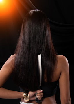 Asian Woman long hair hold Kitchen Knife in hand
