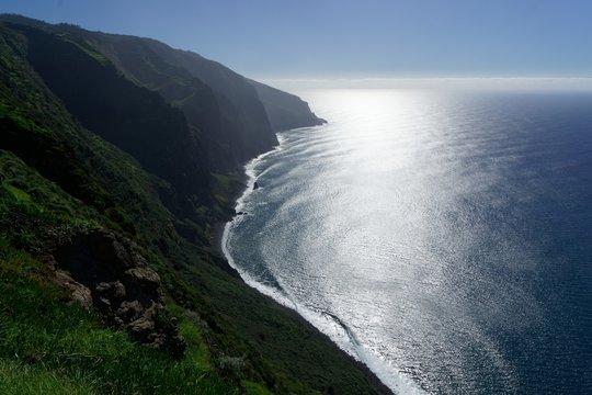 Beautiful shot of an ocean and green hills