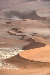 Orange and red-brown sand dunes near Deadvlei in the Namib-Naukluft National Park, Namibia