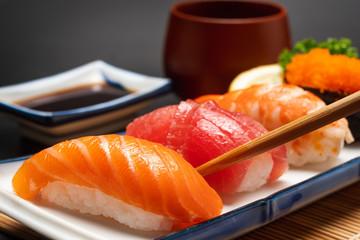 Photo sur Plexiglas Sushi bar Sushi salmon & tuna sushi shrimp and wasabi on the white plate isolated.selective focus