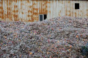 Plastic bottles are stocked to be recycled at the Weeco plastic recycling factory at the Athi River industrial zone near Nairobi
