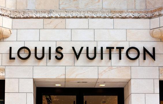Düsseldorf, Germany - August 20, 2011: Louis Vuitton sign on the building at Louis Vuitton store on Königsallee