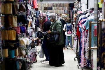 Iraqi women shop for clothes in preparation for Eid Al-Adha celebration in Baghdad