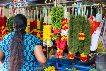 Woman selling flower garlands in Little India