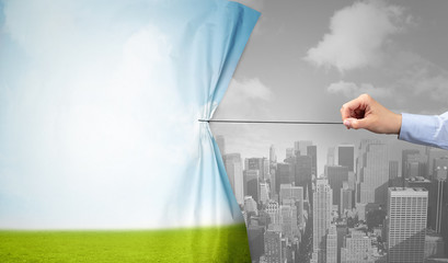 Fotomurales - hand pulling nature cityscape curtain to gray cityscape, environmental protection concept