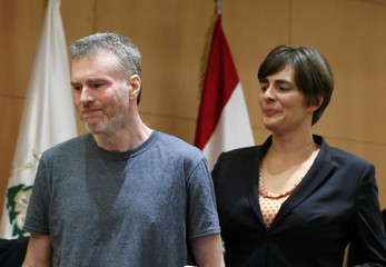 Canadian citizen, Kristian Lee Baxter, who was being held in Syria, reacts next to Canadian Ambassador to Lebanon, Emmanuelle Lamoureux, after being released, at a news conference in Beirut