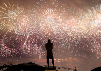 A statue of Sir Stamford Raffles is seen as fireworks explode during Singapore's 54th National Day Parade in Singapore