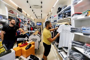 An Iraqi man shops for clothes in preparation for Eid Al-Adha celebration in Baghdad