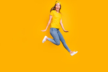 Full body photo of beautiful lady jumping high wear casual clothes isolated yellow background