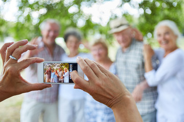 Person takes a photo of seniors group