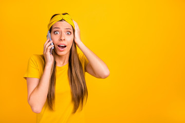 Photo of pretty lady speaking over telephone hearing best news wear casual t-shirt isolated yellow background