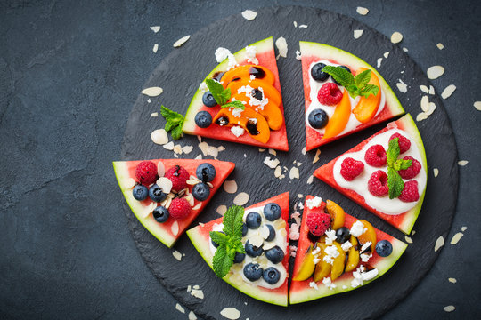 Watermelon pizza with berries, fruits, yogurt, feta cheese