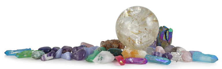 Obraz Row of multicoloured Healing Crystals Background Banner - Huge rutilated Crystal Ball surrounded by various tumbled healing stones and terminated quartz with space for copy - fototapety do salonu