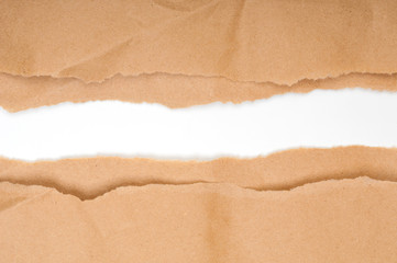 Brown torn paper with white copy space