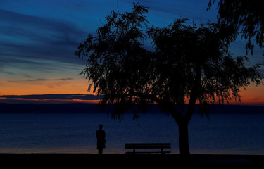 A person is seen during sunset at lake Neusiedl in Podersdorf