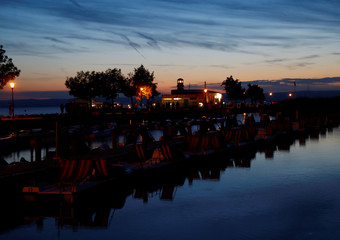 Boats are seen during sunset at lake Neusiedl in Podersdorf