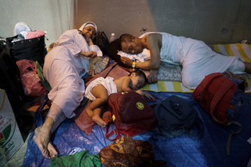 Indonesian pilgrims sleep as they begin gathering in Arafat to mark haj's most important day, Day of Arafat, during their Haj pilgrimage in the holy city of Mecca