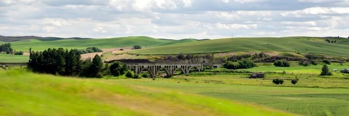 Bridge through the rolling hills of the Palouse region of Washington State.