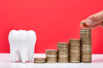 Stack Of Coins In Front Of Healthy Tooth