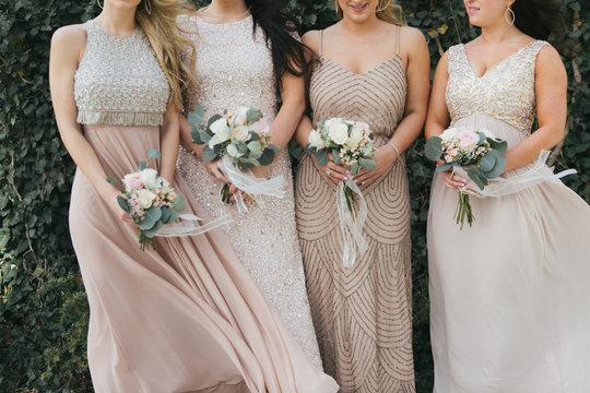 bridesmaids holding wedding bouquets, tan dresses