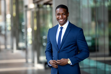 Handsome charming cheerful african american businessman in swanky modern stylish suit and tie, colorful, classy, office building Fotobehang