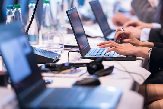 close up of business people hands using laptop computer