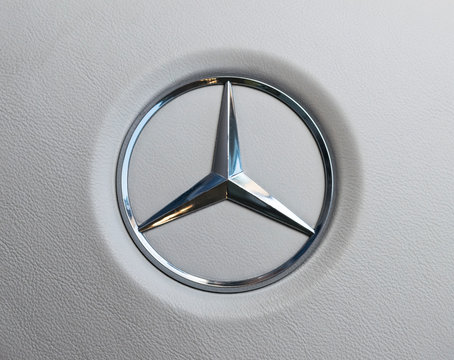 Imatra, Finland, September 3 2017: Close up view of a Mercedes-Benz logo on white leather steering wheel. Modern car interior details.