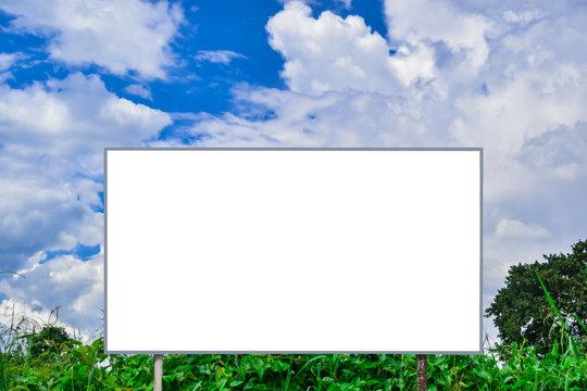 Blank billboard against blue sky background for advertisement or design.