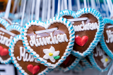 Oktoberfest Gingerbread heart with Munich Letters. October festival is a seasonal beer event in Munich (Germany). Traditional heart cakes.