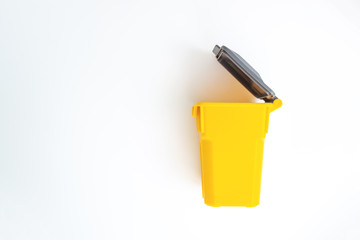 Mini yellow trash on the white screen isolated