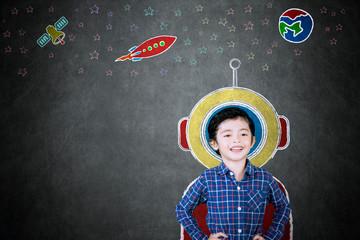Little boy imagining being an astronaut