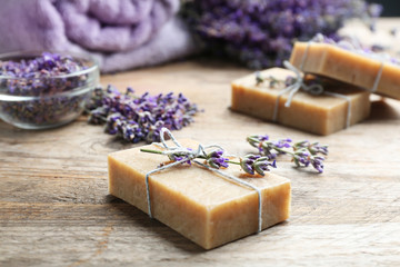 Wall Mural - Handmade soap bars with lavender flowers on brown wooden table, closeup. Space for text