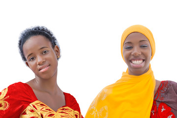 Two smiling teenagers girls wearing traditional dresses, isolated, white background