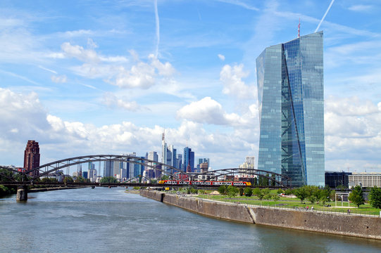 view of the river Main with the headquarters of ECB and the skyline of Frankfurt. European Central Bank and Skyscraper buildings in Germany with blue sky background. Business and finance concept