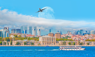 """Airplane flying above the Dolmabahce palace with full moon - Istanbul, Turkey """"Elements of this image furnished by NASA """""""
