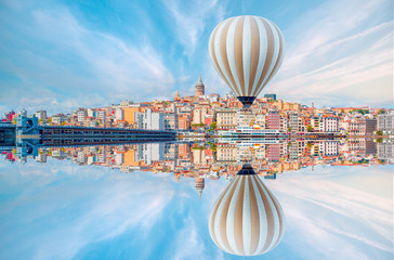 Hot air balloon flying over Galata tower, istanbul