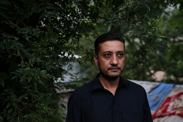 Aijaz Ahmed Meer, a trader whose wife with two daughters are visiting relatives in Srinagar and who are unable to contact due to the Internet and mobile networks shutdown, talks with Reuters in Muzaffarabad