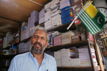 Ali Mohammad, who is a former militant and works at a stationery shop speaks with Reuters in Muzaffarabad
