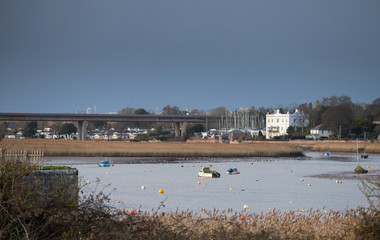 View on Topsham and the automobile bridge over the canal and the river Exe. Several moored boats are visible. Neighborhood Exeter. Devon. UK