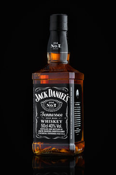 MINSK, BELARUS - OCTOBER 3, 2016: Bottle of Jack Daniel's tennessee sour mash old no. 7 whiskey isolated on black background with reflection. Jack Daniel's is a brand of Tennessee whiskey and the top