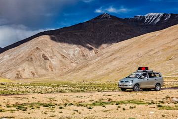 LADAKH, INDIA - SEPTEMBER 8, 2011: Toyota Modern MPV car on road in Himalayas mountains