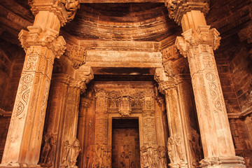 Ceiling and stone altar inside sacred Hindu temple in Khajuraho, India. Ancient columns in 10th century indian temple