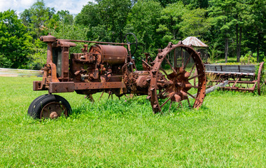 Old tractor in farm field