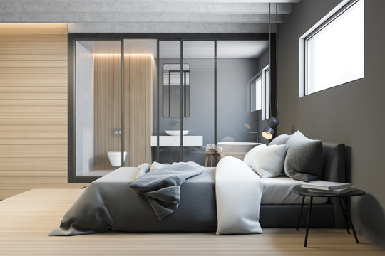 Side view of gray master bedroom with bathroom