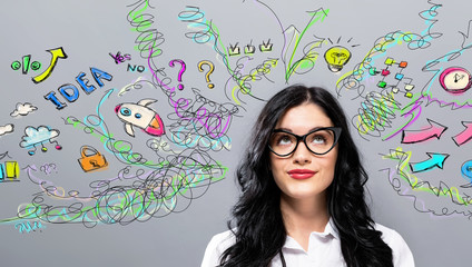 Many thoughts with young businesswoman in a thoughtful face Wall mural