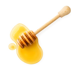 Stick with honey on a white background. The view of the top.